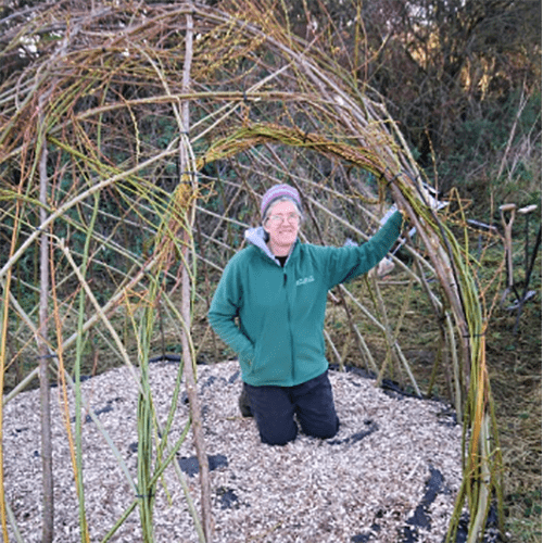 Ruth besides her living willow dome